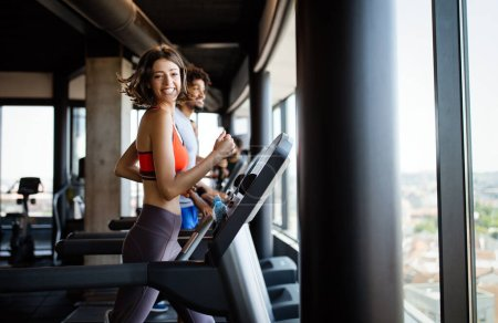 Photo for Picture of fit people running on treadmill in gym - Royalty Free Image