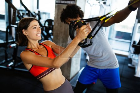 Photo for Sport, fitness, lifestyle and people concept. Fit people exercising in gym - Royalty Free Image