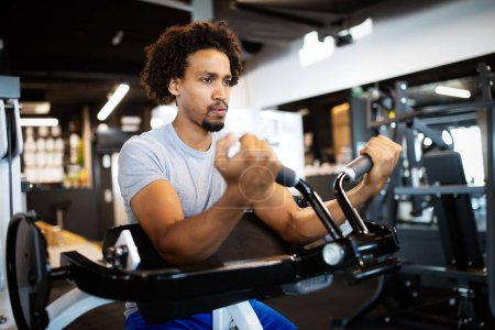 Photo for Fitness, sport, exercising, training and lifestyle concep Young fit man working out in gym - Royalty Free Image