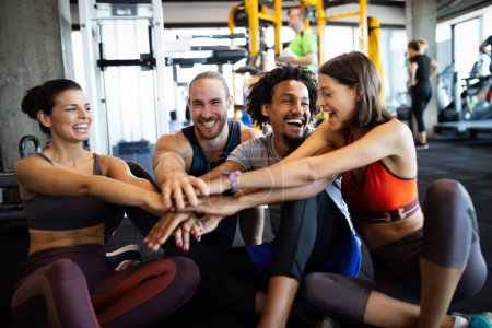 Photo for Happy fit people exercising, working out in gym to stay healthy together - Royalty Free Image