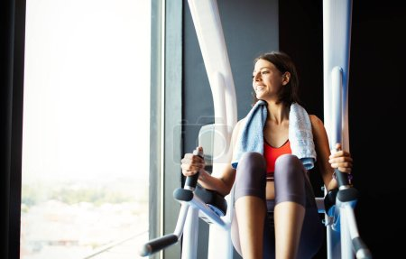 Attractive young fit woman working out in gym. Sport, fitness, healthy lifestyle concept