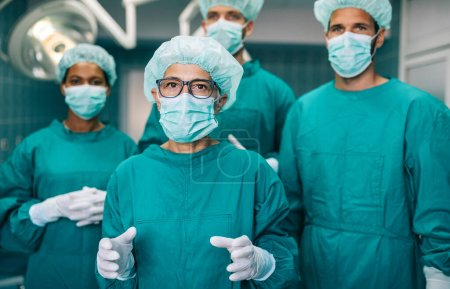 Photo for Team of surgeons in the operating room preparing for surgery in hospital - Royalty Free Image