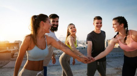 Photo for Fitness, sport, friendship and healthy lifestyle concept. Group of happy friends or sportsmen exercising outdoor - Royalty Free Image