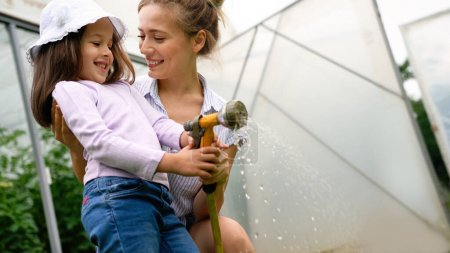 Photo for Beautiful happy mother and daughter working in the farm, garden. Family, happiness concept. - Royalty Free Image