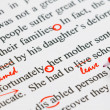 Closeup red marks on proofreading english document...