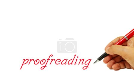 Proofreading text on white and hand holding red pe...