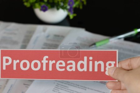 Proofreading English card over blurred text on bla...