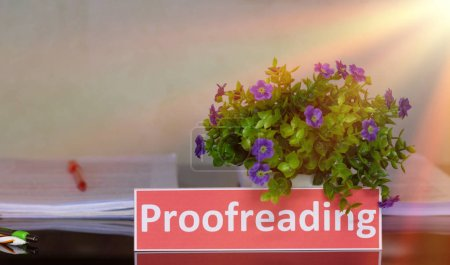 Proofreading English card on black table in office...
