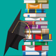 Graduation cap on stack of books. Academic and sch...
