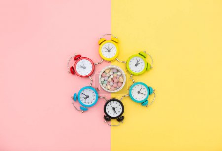 photo of colorful alarm clocks and powder on the wonderful backg