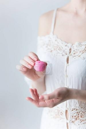 photo of young woman holding pink marshmallow on the wonderful w