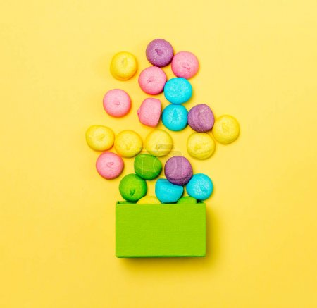 colorful marshmallows and green box