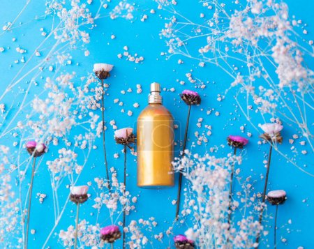 golden perfume bottle and flowers