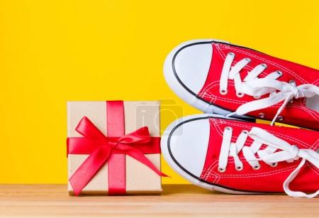 red sporty gumshoes and gift box