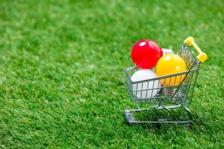 shopping cart full of light bulbs