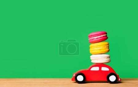 toy car carrying macarons