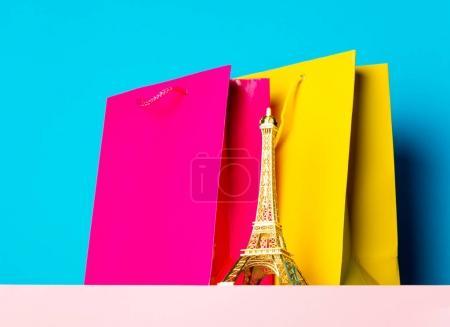 shopping bags and Eiffel tower souvenir