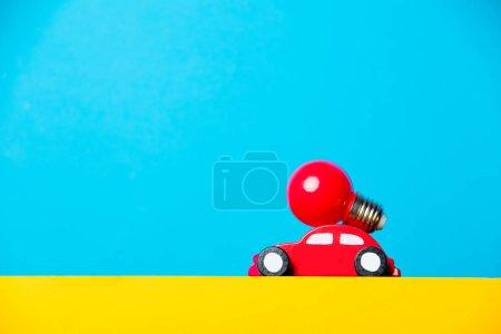 toy car carrying lightbulb