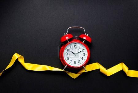 clock and yellow ribbon