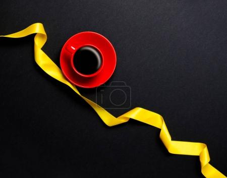 coffee cup and yellow ribbon