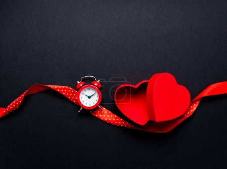 photo of red hearts with ribbon