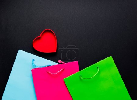 red heart with colorful shopping bags