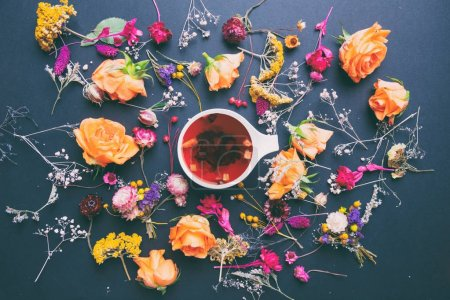 herbs and flowers with cup of tea