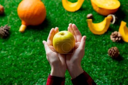 female hands holding apple