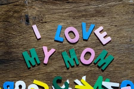 Mothers day concept - I Love My Mom texts on Wooden Background