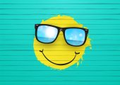 Yellow Smiley wearing sunglasses.