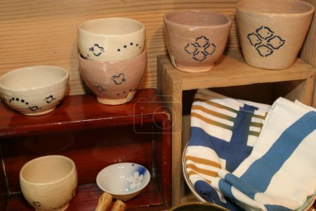 Ceramic bowls on shelves