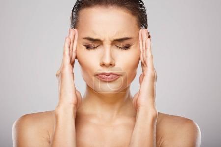 girl suffering from  headache.