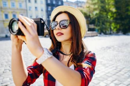 tourist making photo with camera