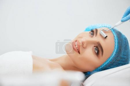 woman  lying  in cosmetological clinic