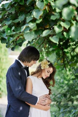 bride and bridegroom standing close