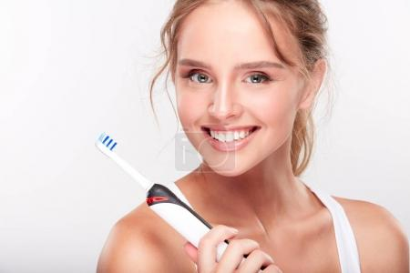 Model holding toothbrush