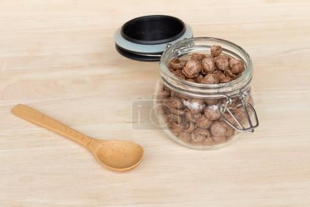 Chocolate cereal cornflakes in the glass jar