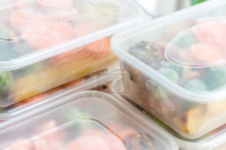 Photo for Meal prep. Close up of home cooked roast chicken dinners in containers ready to be frozen for later use. - Royalty Free Image