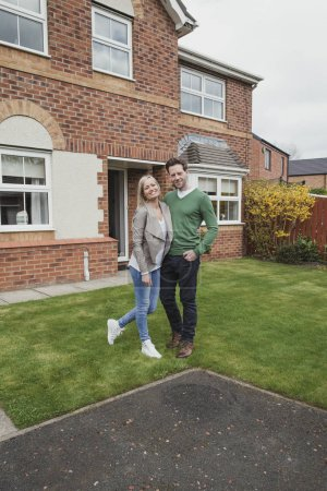 Happy Couple With New Home