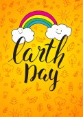 Happy Earth Day Card Vector greeting card Yellow background with pop art clouds and rainbow Handwritten inscription Earth Day Modern calligraphy Brush lettering Hand drawn elements