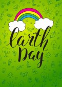 Happy Earth Day Card Vector greeting card Green background with pop art clouds and rainbow Handwritten inscription Earth Day  Modern calligraphy Brush lettering Hand drawn elements