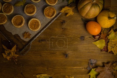 Photo for Thanksgiving concept - making mini pumpkin pies, top view - Royalty Free Image