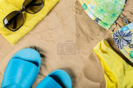 Photo for Summer concept - bathing suit, sunglasses, flip flops, towel, top view above overhead - Royalty Free Image