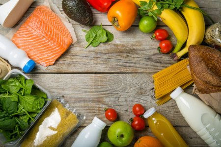 Photo for Grocery shopping concept. Balanced diet concept. Fresh foods with shopping bag on rustic wood background, top view, copy space, flat lay - Royalty Free Image