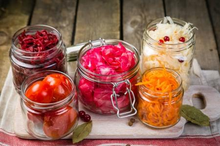 Photo for Selection of fermented food - carrot, cabbage, tomatoes, beetroot, copy space wood background - Royalty Free Image