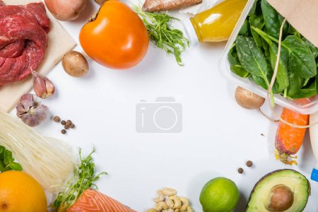 Photo for Grocery shopping concept. Balanced diet concept. Fresh foods with shopping bag on white background, top view, copy space, flat lay - Royalty Free Image
