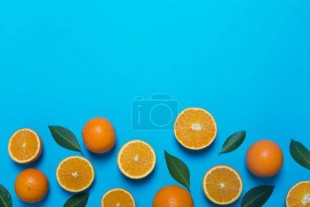 Fresh oranges on the blue background