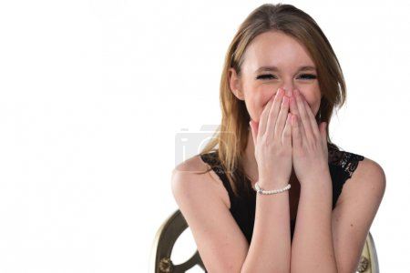 Portrait of young beautiful woman laughing and covering the face with her hands. isolated on white background