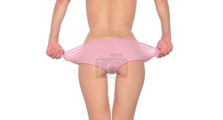 woman taking off panties