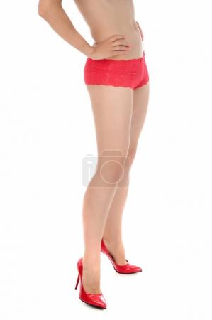 beautiful woman's body in red underwear and red high heels